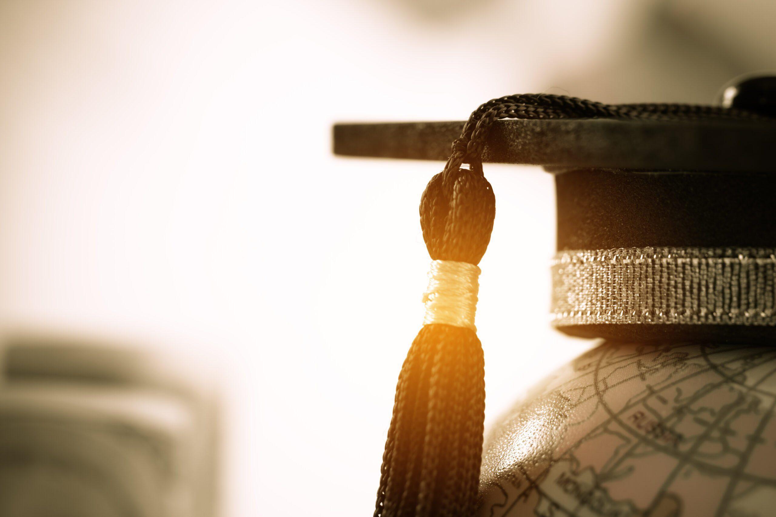 Graduated,study,abroad,international,conceptual,,graduation,hat,on,top,earth